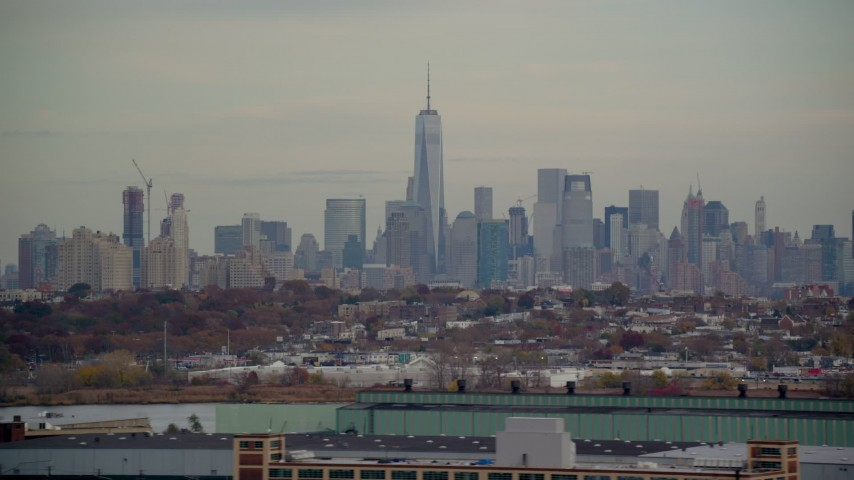 6K stock footage aerial video of Freedom Tower and Lower Manhattan skyline seen from Jersey City in Autumn Aerial Stock Footage | AX120_274