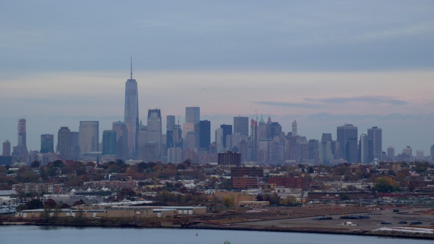 5.5K stock footage aerial video of the Lower Manhattan skyline at twilight in Autumn, New York City Aerial Stock Footage | AX121_003E
