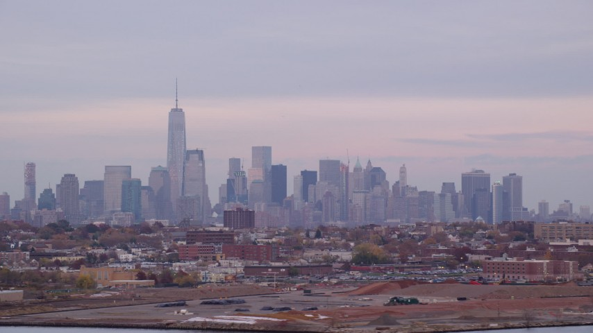6K stock footage aerial video of the city skyline of Lower Manhattan at twilight in Autumn, New York City Aerial Stock Footage | AX121_004
