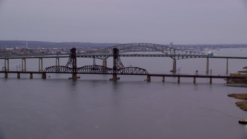 6K stock footage aerial video of the Newark Bay Bridge and Lehigh Valley Bridge at twilight, New Jersey Aerial Stock Footage | AX121_005