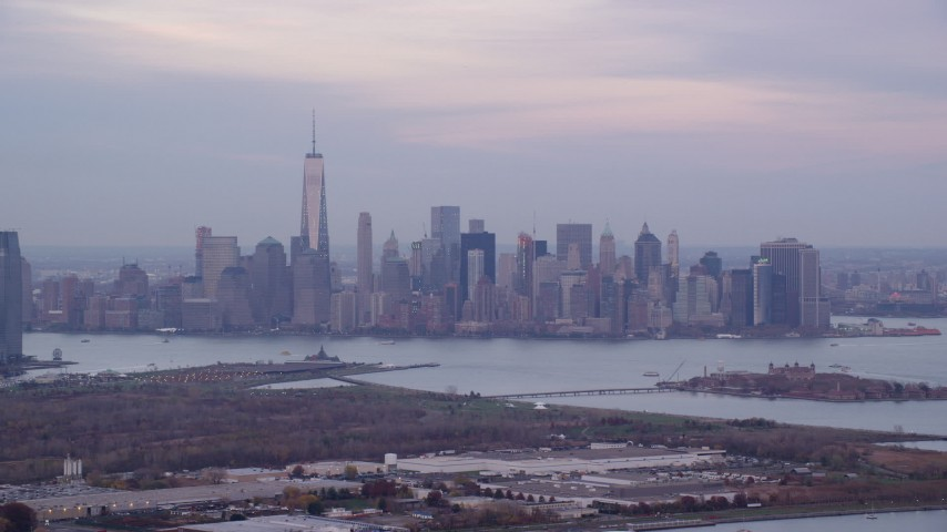Lower Manhattan Skyline at twilight in Autumn, New York City Aerial Stock Footage | AX121_010