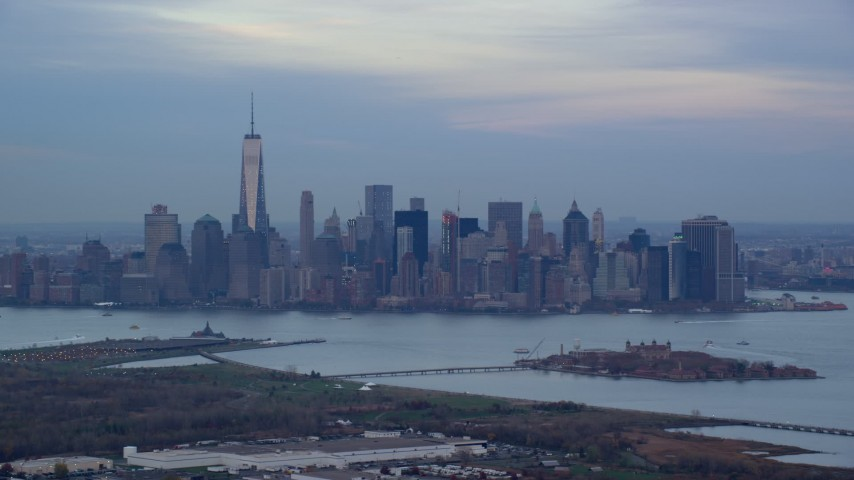 5.5K stock footage aerial video of the Lower Manhattan skyline at twilight in Autumn, New York City Aerial Stock Footage   AX121_010E