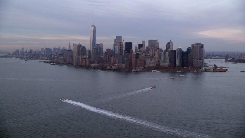 Orbit Lower Manhattan Skyline at twilight in Autumn, New York City Aerial Stock Footage   AX121_016