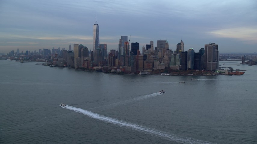 5.5K stock footage aerial video of the Lower Manhattan skyline at twilight in Autumn, New York City Aerial Stock Footage | AX121_016E