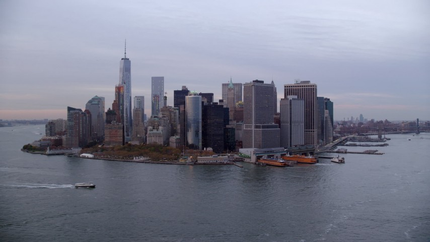 Orbit Battery Park and Skyline of Lower Manhattan at twilight, New York City Aerial Stock Footage | AX121_019