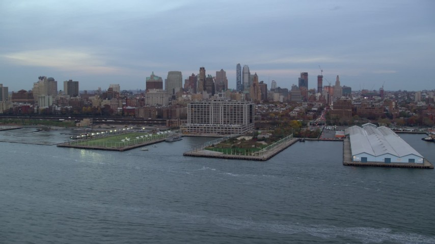 6K stock footage aerial video approach piers on the shore of Brooklyn at twilight in New York City Aerial Stock Footage | AX121_020