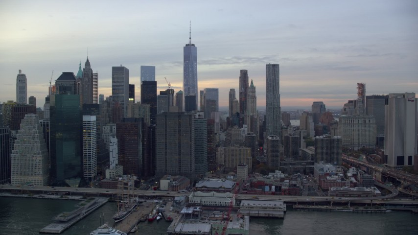 6K stock footage aerial video of the city's skyscrapers in Lower Manhattan at twilight, New York City Aerial Stock Footage | AX121_024