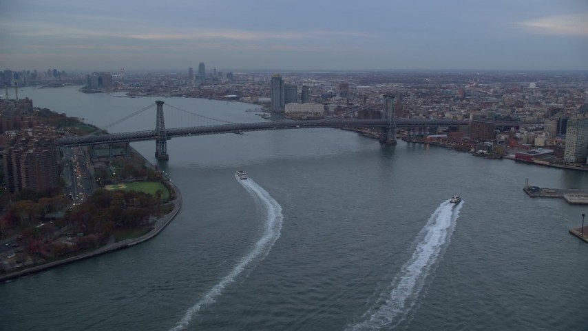6K stock footage aerial video of approaching the Williamsburg Bridge at twilight in New York City Aerial Stock Footage | AX121_026