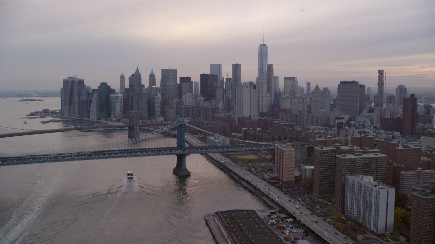 6K stock footage aerial video approach Manhattan Bridge and Lower Manhattan skyline at twilight in New York City Aerial Stock Footage | AX121_028