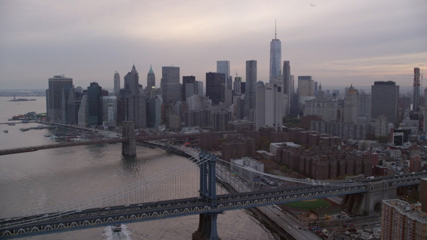 6K stock footage aerial video approach Brooklyn Bridge, Manhattan Bridge and Lower Manhattan at twilight in New York City Aerial Stock Footage | AX121_029
