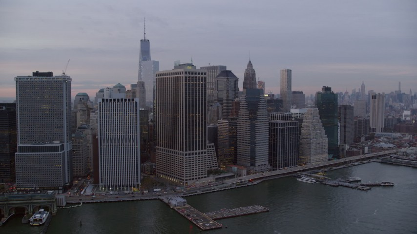 6K stock footage aerial video of riverfront Lower Manhattan skyscrapers at twilight in New York City Aerial Stock Footage | AX121_036