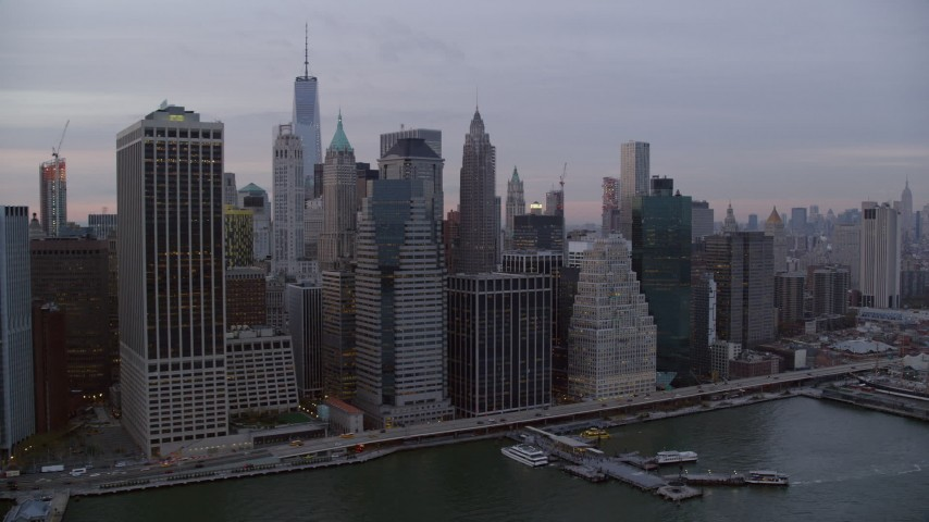 6K stock footage aerial video of passing riverfront Lower Manhattan high-rises at twilight in New York City Aerial Stock Footage | AX121_037