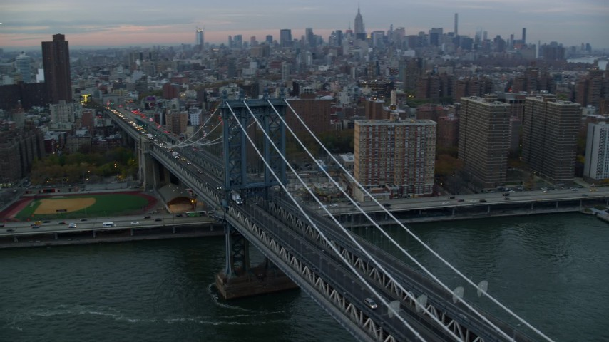 6K stock footage aerial video orbit Manhattan Bridge at twilight in New York City Aerial Stock Footage | AX121_041