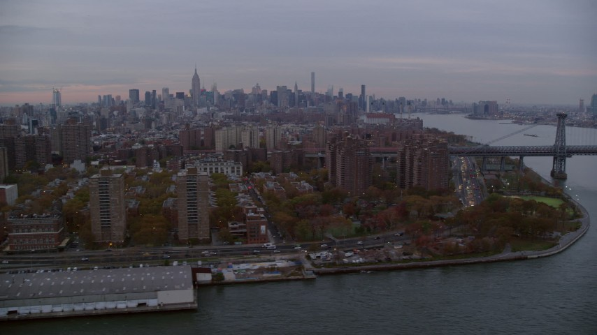 6K stock footage aerial video of Lower East Side projects and Williamsburg Bridge at twilight in New York City Aerial Stock Footage | AX121_043