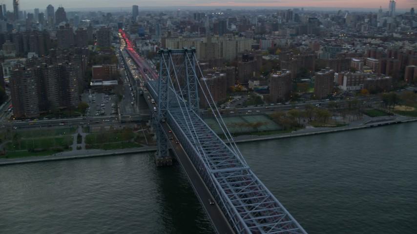 6K stock footage aerial video orbit Williamsburg Bridge at twilight in New York City Aerial Stock Footage | AX121_045