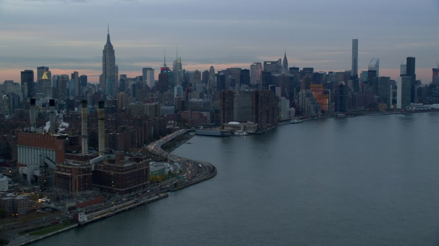 5.5K stock footage aerial video of an East Village power plant and Midtown skyscrapers at twilight in New York City Aerial Stock Footage | AX121_046E