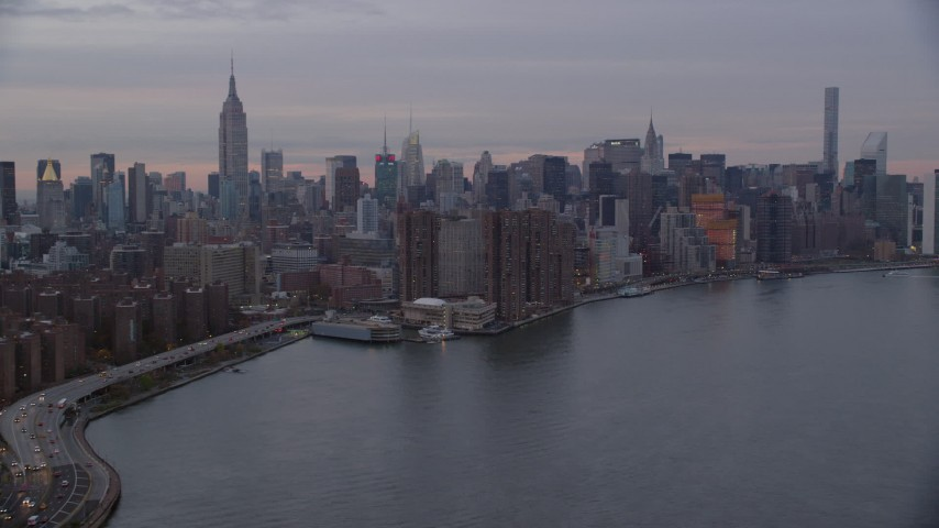 6K stock footage aerial video of riverfront high-rises in Midtown at twilight in New York City Aerial Stock Footage | AX121_047