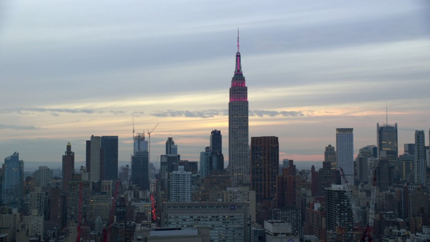 6K stock footage aerial video orbit Empire State Building at twilight in New York City Aerial Stock Footage | AX121_050