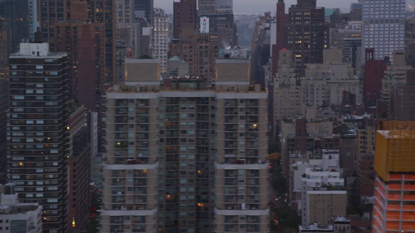 City Streets in Midtown at twilight in New York City Aerial Stock Footage | AX121_051
