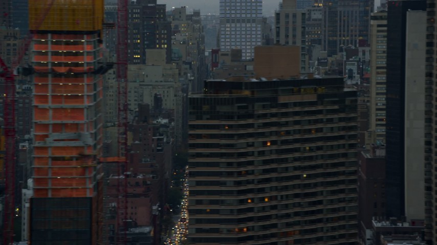 5.5K stock footage aerial video of city streets in Midtown at twilight in New York City Aerial Stock Footage   AX121_051E