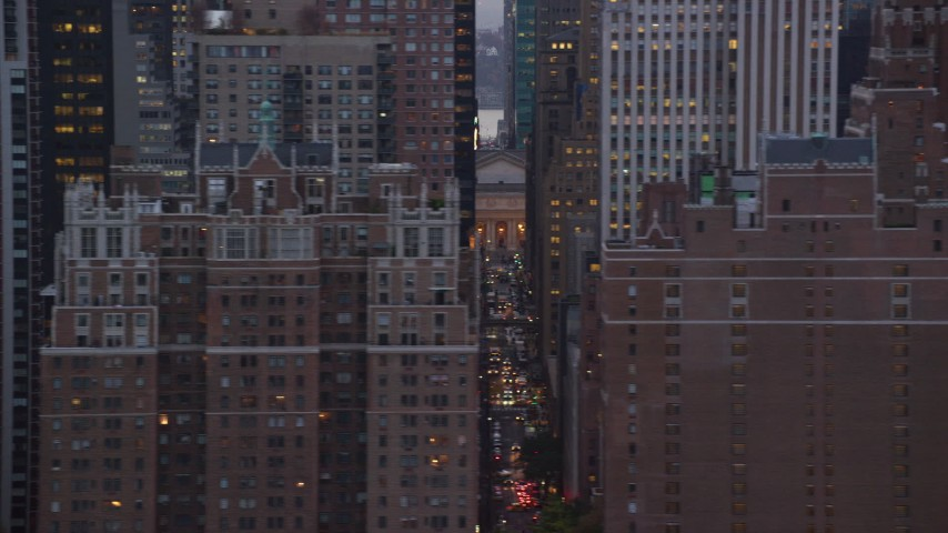 6K stock footage aerial video of passing city streets and Midtown high-rises at twilight in New York City Aerial Stock Footage | AX121_052