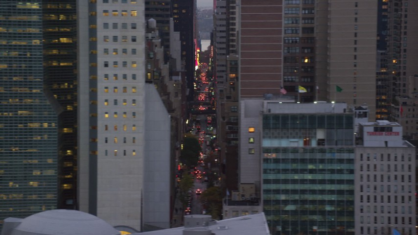 6K stock footage aerial video reveal city streets and skyscrapers in Midtown at twilight in New York City Aerial Stock Footage | AX121_053