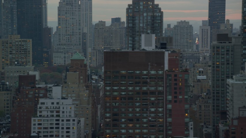 5.5K stock footage aerial video flyby streets and Midtown Manhattan skyscrapers at twilight in New York City Aerial Stock Footage | AX121_056E