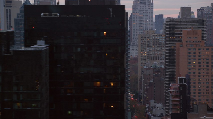 Streets and High-Rises in Midtown Manhattan at twilight in New York City Aerial Stock Footage | AX121_057