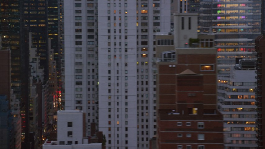 6K stock footage aerial video of busy Midtown streets and skyscrapers at twilight in New York City Aerial Stock Footage | AX121_062