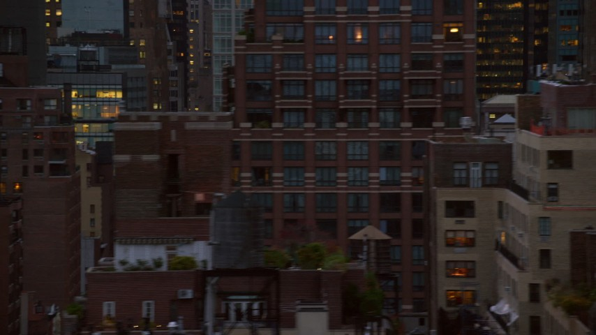 6K stock footage aerial video of Midtown skyscrapers and busy streets at twilight in New York City Aerial Stock Footage | AX121_064