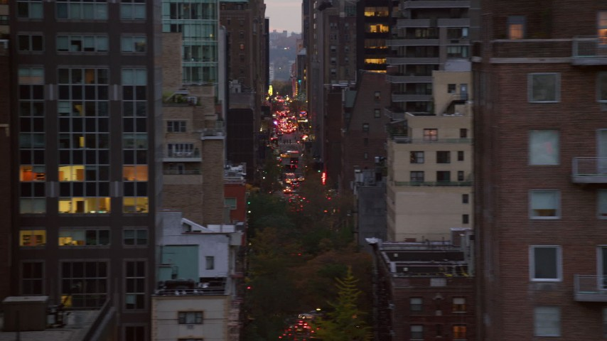 High-Rises and Congested Streets in Midtown at twilight in New York City Aerial Stock Footage | AX121_065