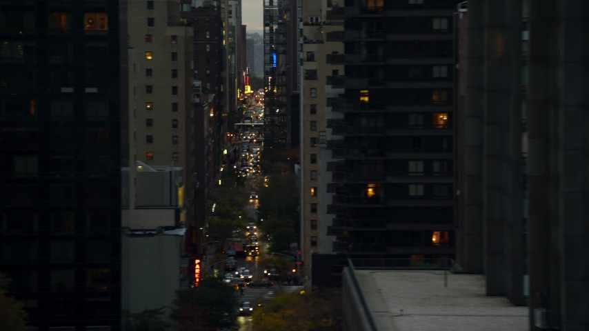5.5K stock footage aerial video of high-rises and congested streets in Midtown at twilight in New York City Aerial Stock Footage   AX121_065E