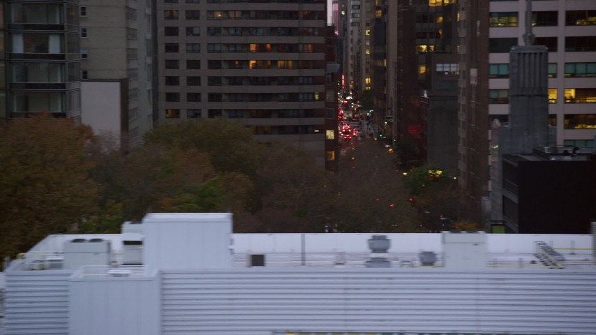 6K stock footage aerial video of Midtown high-rises and busy city streets at twilight in New York City Aerial Stock Footage   AX121_066