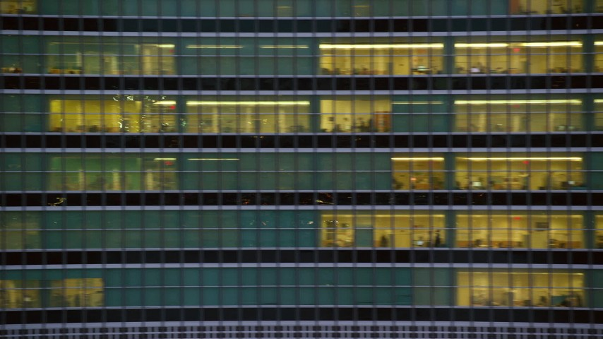 Midtown City Canyons and Reveal UN Building at twilight in New York City Aerial Stock Footage | AX121_068