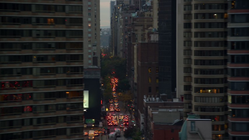 5.5K stock footage aerial video of Midtown city canyons and reveal UN Building at twilight in New York City Aerial Stock Footage | AX121_068E