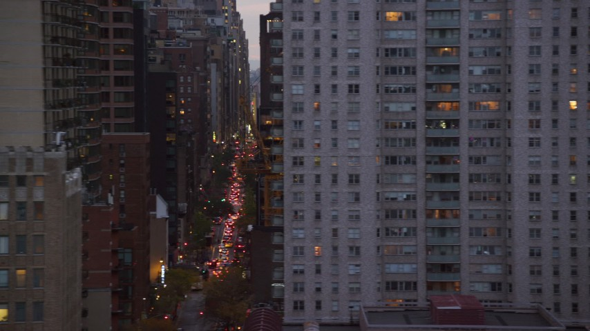6K stock footage aerial video of busy Midtown Manhattan streets and skyscrapers at twilight in New York City Aerial Stock Footage | AX121_070