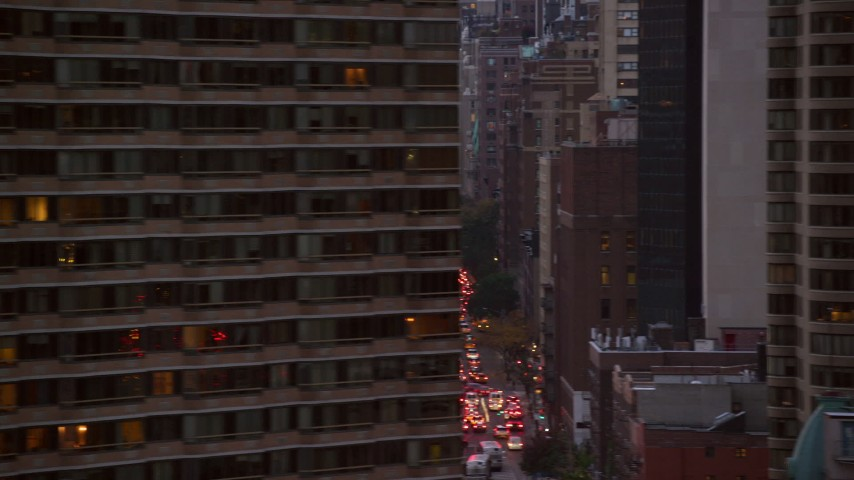 6K stock footage aerial video flyby city canyons in Midtown at twilight in New York City Aerial Stock Footage | AX121_071