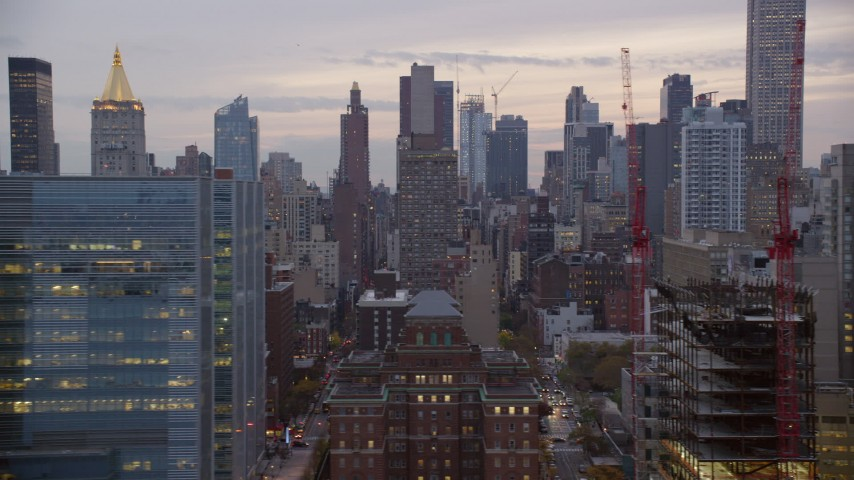 Midtown Skyscrapers at twilight in New York City Aerial Stock Footage | AX121_073