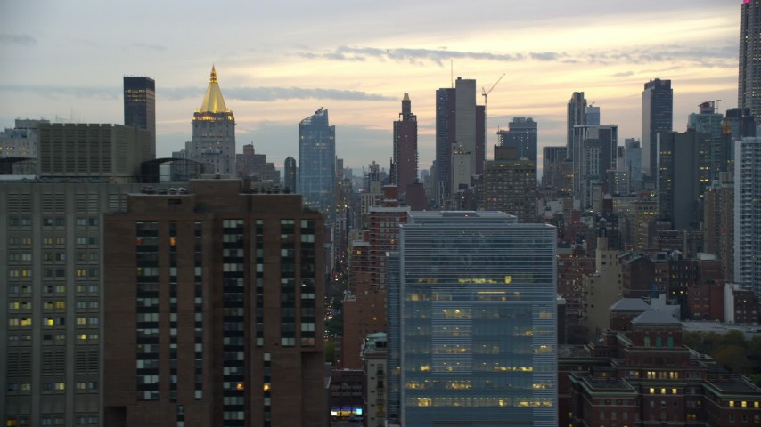 5.5K stock footage aerial video of Midtown skyscrapers at twilight in New York City Aerial Stock Footage | AX121_073E