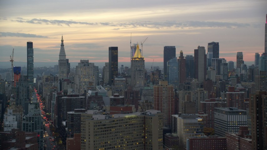 6K stock footage aerial video of skyscrapers near Empire State Building at twilight in New York City Aerial Stock Footage | AX121_075