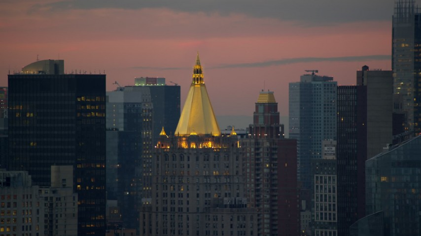 New York Life Building in Midtown at twilight in New York City Aerial Stock Footage | AX121_076