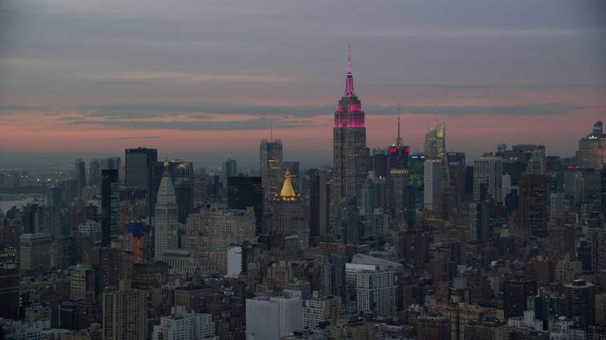 6K stock footage aerial video of Empire State Building at twilight in Midtown, New York City Aerial Stock Footage | AX121_077