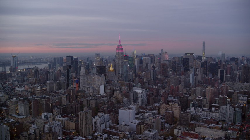6K stock footage aerial video approach Empire State Building and Midtown skyscrapers at twilight in New York City Aerial Stock Footage | AX121_078