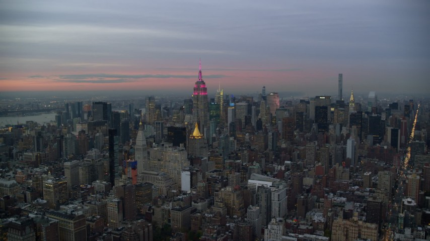 5.5K stock footage aerial video approach Empire State Building and Midtown skyscrapers at twilight in New York City Aerial Stock Footage | AX121_078E