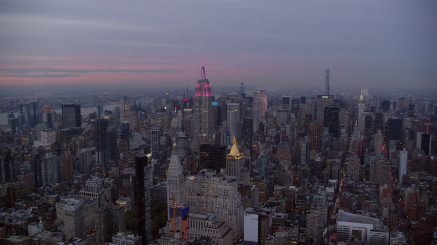 Orbit Empire State Building and Skyscrapers at twilight in New York City Aerial Stock Footage | AX121_080