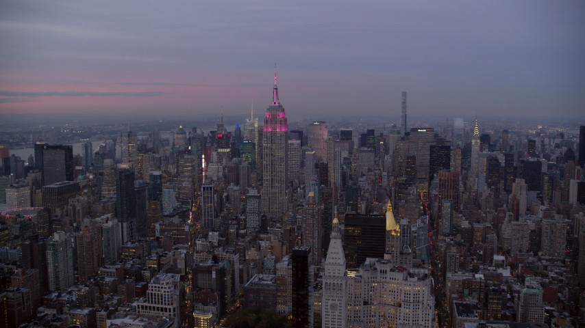 Orbit Empire State Building and Midtown High-Rises at twilight in New York City Aerial Stock Footage | AX121_081