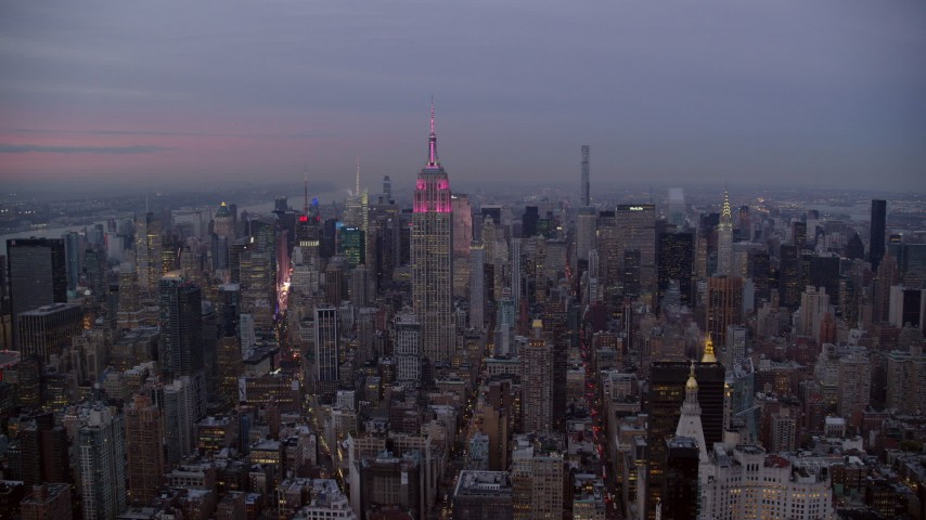 6K stock footage aerial video wide orbit of the Empire State Building in Midtown at twilight in New York City Aerial Stock Footage | AX121_082