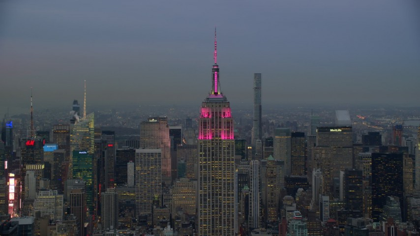 6K stock footage aerial video orbit top of Empire State Building at twilight in New York City Aerial Stock Footage | AX121_083