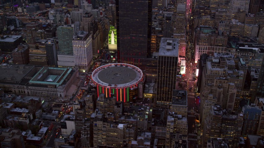 6K stock footage aerial video approach Madison Square Garden at twilight in New York City Aerial Stock Footage | AX121_084