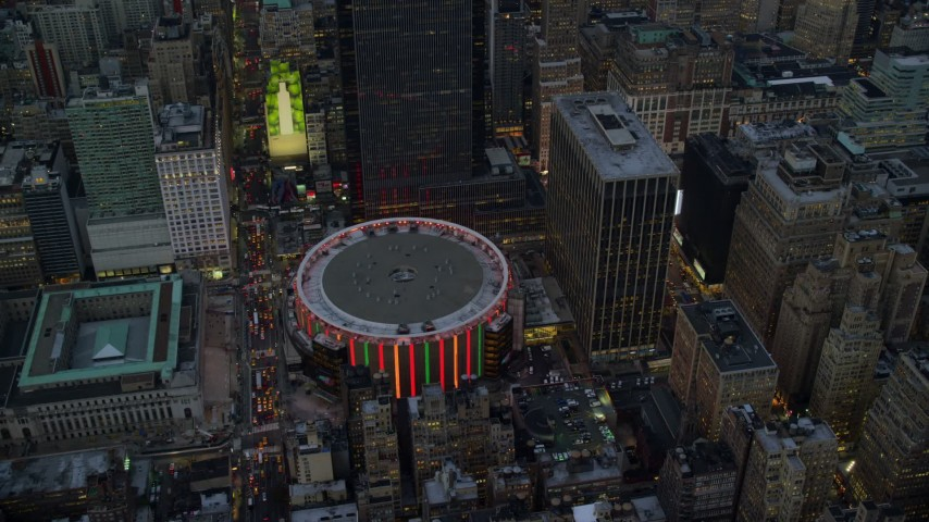 5.5K stock footage aerial video approach and orbit Madison Square Garden at twilight in New York City Aerial Stock Footage | AX121_084E